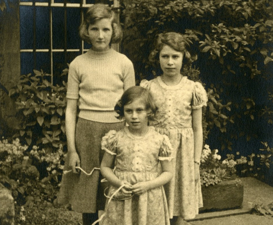 Princesses Elizabeth and Margaret (left and centre)