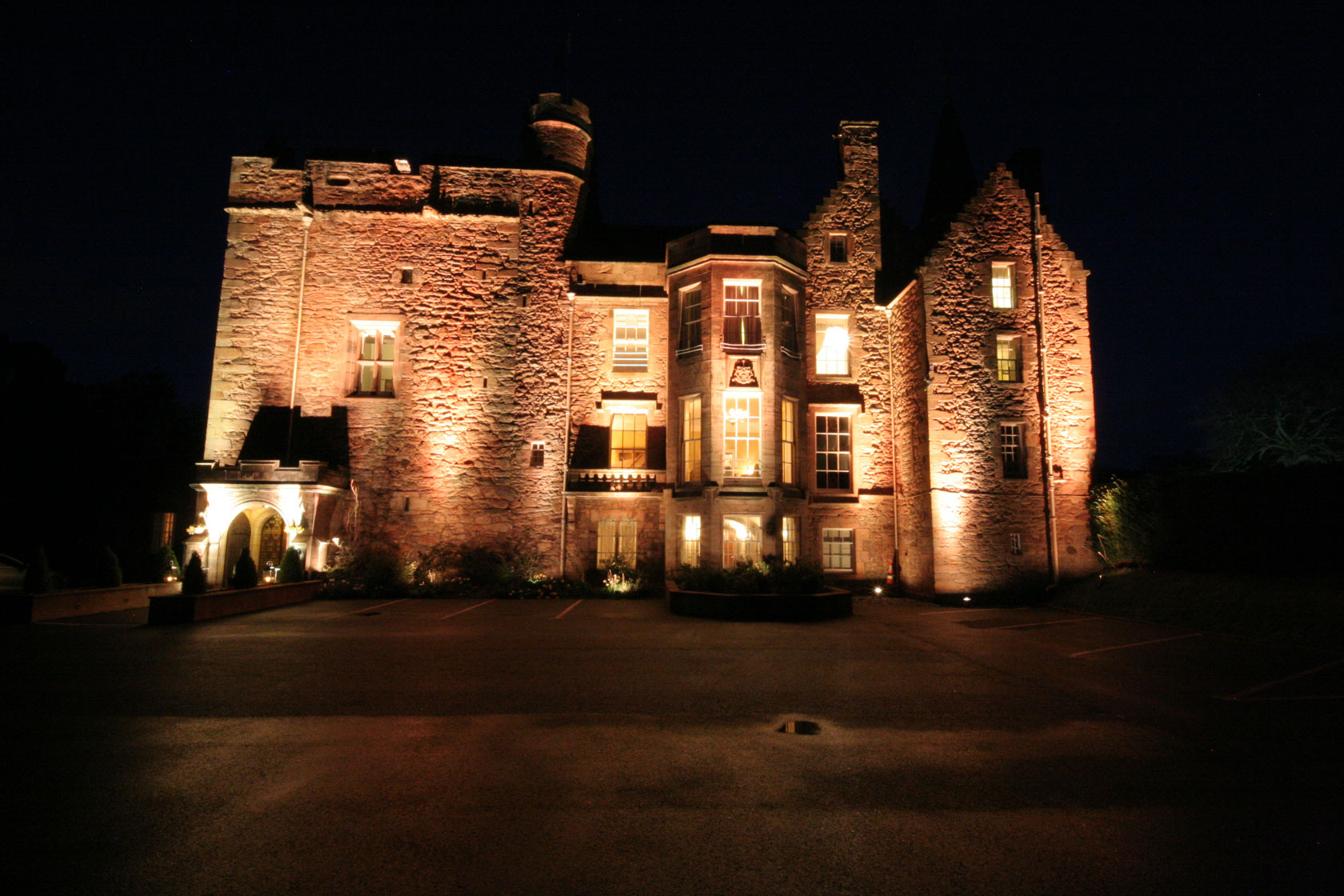 Carberry Tower Castle at night